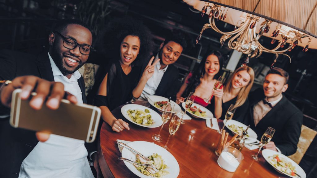 Group of friends at a restaurant taking a selfie
